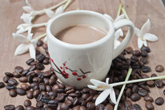 Cup of coffee. Flowers and cup of coffee on table Stock Photo