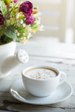 Cup of coffee with flowers Stock Photo