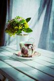 Cup of coffee and flowers Royalty Free Stock Images