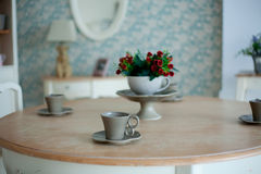 Cup of coffee and flowers on the wooden table Royalty Free Stock Images