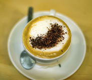 Cup of coffee with foam Stock Photos