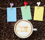 A cup of coffee with foam milk art 2015 pattern Stock Photos