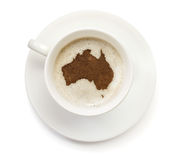 Cup of coffee with foam and powder in the shape of Australia.(series). A cup of coffee with foam and powder in the shape of Australia.(series stock photos