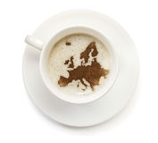 Cup of coffee with foam and powder in the shape of Europe.(serie Stock Photography