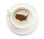Cup of coffee with foam and powder in the shape of USA.(series) Stock Images