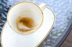 A cup of coffee with foam on the walls of the pot. Empty cup from coffee royalty free stock photo