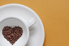 A cup of coffee in the form of heart Royalty Free Stock Photography