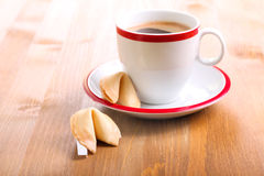 Cup of coffee and fortune cookie Stock Photos