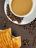 Cup of coffee and french chocolate croissant Royalty Free Stock Images