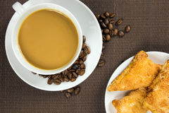 Cup of coffee and french chocolate croissant Stock Image