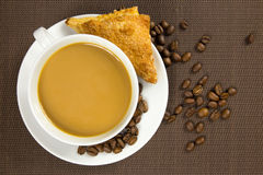 Cup of coffee and french chocolate croissant Royalty Free Stock Photography