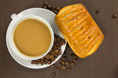 Cup of coffee and french chocolate croissant Royalty Free Stock Photo