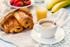 Cup of coffee with french croissant with chocolate Royalty Free Stock Photos