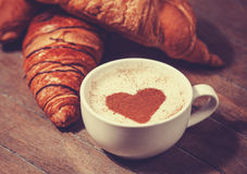 Cup of coffee with french croissant Royalty Free Stock Photo