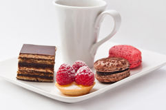 Cup of coffee with french pastry Stock Images