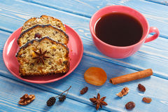 Cup of coffee and fresh baked fruitcake on boards Stock Photos