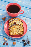 Cup of coffee and fresh baked fruitcake on boards Royalty Free Stock Images