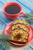 Cup of coffee, fresh baked fruitcake for Christmas and spruce branches Stock Image