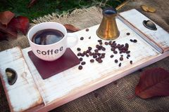 Cup of coffee. Cup of fresh coffee and coffee beans on the wooden tray Stock Photos