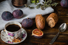Cup of coffee with fresh bread and some figs. Cup of coffee with fresh bread and some ripe figs on wooden surface Stock Photo