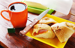 Cup of coffee and fresh bun for breakfast Royalty Free Stock Image