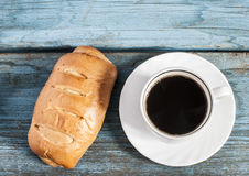 Cup of coffee and fresh bun Royalty Free Stock Photo