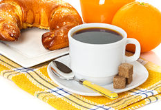 Cup of coffee, fresh croissant and juice orange Stock Images
