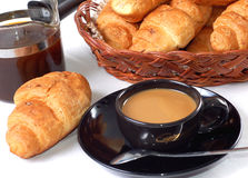 Cup of coffee with fresh croissants stock image