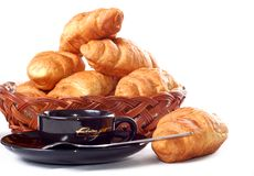 Cup of coffee with fresh croissants Royalty Free Stock Photo