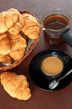 Cup of coffee with fresh croissants Royalty Free Stock Images