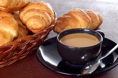 Cup of coffee with fresh croissants Stock Images