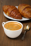Cup of coffee and fresh croissants, vertical Royalty Free Stock Photography