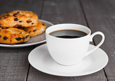 Cup of coffee with fresh fruit scones with raisins Stock Photos