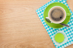 Cup of coffee and fresh macaroon Stock Photos