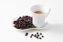 Cup of coffee and fresh roasted organic Coffee beans. On  background, food and drink background Stock Photo