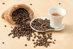 Cup of coffee and fresh roasted organic Coffee beans. On  background, food and drink background Royalty Free Stock Photo