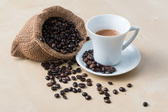 Cup of coffee and fresh roasted organic Coffee beans Stock Photos