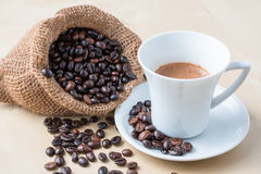 Cup of coffee and fresh roasted organic Coffee beans Stock Photography