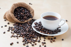 Cup of coffee and fresh roasted organic Coffee beans Royalty Free Stock Images