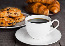 Cup of coffee with fresh scones and croissants Stock Photos