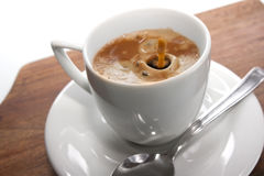 Cup of coffee. Freshly poured coffee into the cup Royalty Free Stock Image