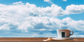 A cup of coffee in front of a cloudy sky Stock Image