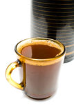 Cup of coffee  in front of thermos Stock Image