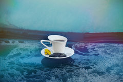 Cup of coffee on a frozen blue car. Hot strong Cup of coffee with chocolate on the frozen hood of the blue car. Morning, cold, frost, hoarfrost, waiting Royalty Free Stock Images
