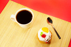Cup of coffee and fruit cake on bamboo Stock Image