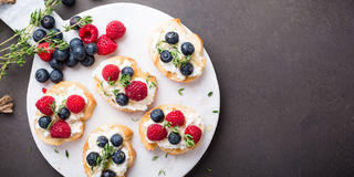 Cup of coffee with fruit sandwiches Stock Photos