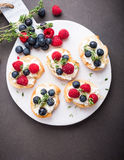 Cup of coffee with fruit sandwiches Royalty Free Stock Photos