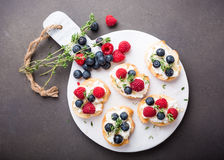 Cup of coffee with fruit sandwiches Royalty Free Stock Images