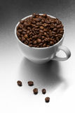 Cup of coffee, full of beans. Stock Images