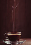 Cup of coffee with fume Stock Photos